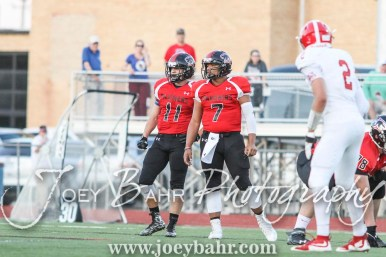 Great Bend Panthers Cal Marshall (#11) and Jacob Murray (#7) look to the sideline for the next play to run. The Great Bend Panthers defeated the Dodge City Demons 34 to 27 at Memorial Stadium in Great Bend, Kansas on September 23, 2016. (Photo: Joey Bahr, www.joeybahr.com)