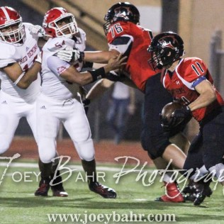 Great Bend Panther Cal Marshall (#11) carries the ball as Aaron Clark (#76) blocks Dodge City Demon Marcos Fisher (#54) The Great Bend Panthers defeated the Dodge City Demons 34 to 27 at Memorial Stadium in Great Bend, Kansas on September 23, 2016. (Photo: Joey Bahr, www.joeybahr.com)