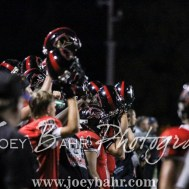 The Great Bend Panther sideline holds up their helmets during a kickoff. The Great Bend Panthers defeated the Dodge City Demons 34 to 27 at Memorial Stadium in Great Bend, Kansas on September 23, 2016. (Photo: Joey Bahr, www.joeybahr.com)