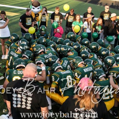 The Pratt Greenbacks kneel for a prayer before running onto the field. The Hoisington Cardinals defeated the Pratt Greenbacks 32 to 14 at Zerger Field in Pratt, Kansas on September 30, 2016. (Photo: Joey Bahr, www.joeybahr.com)
