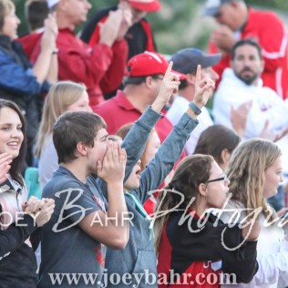 Fans of the Hoisington Cardinals celebrate a touchdown being scored. The Hoisington Cardinals defeated the Pratt Greenbacks 32 to 14 at Zerger Field in Pratt, Kansas on September 30, 2016. (Photo: Joey Bahr, www.joeybahr.com)