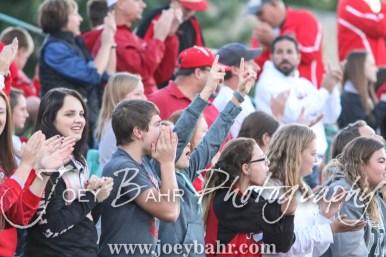 Fans of the Hoisington Cardinals celebrate a touchdown being scored. The Hoisington Cardinals defeated the Pratt Greenbacks 32 to 14 at Zerger Field in Pratt, Kansas on September 30, 2016. (Photo: Joey Bahr, www.joeybahr.com)
