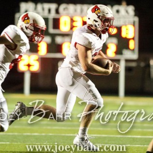 Hoisington Cardinal Hunter Hanzlick (#27) rushes with the ball. The Hoisington Cardinals defeated the Pratt Greenbacks 32 to 14 at Zerger Field in Pratt, Kansas on September 30, 2016. (Photo: Joey Bahr, www.joeybahr.com)