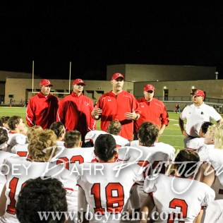 Hoisington Cardinal Head Coach Zach Baird addresses his players following the game. The Hoisington Cardinals defeated the Pratt Greenbacks 32 to 14 at Zerger Field in Pratt, Kansas on September 30, 2016. (Photo: Joey Bahr, www.joeybahr.com)