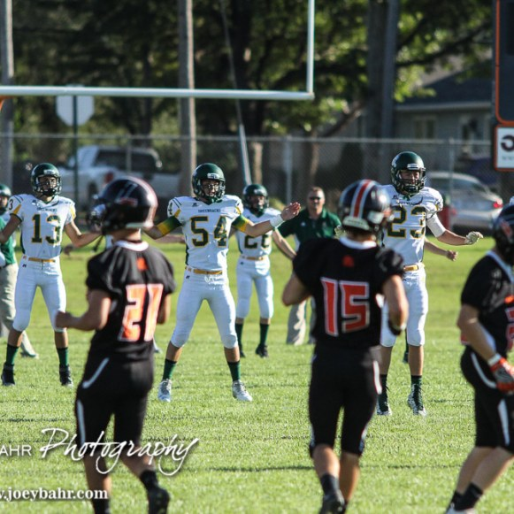 The Pratt Greenbacks and Larned Indians warm up prior to the game. The Pratt Greenbacks win 31 to 16 over the Larned Indians at Earl Roberts Field in Larned, Kansas on September 2, 2016. (Photo: Joey Bahr, www.joeybahr.com)
