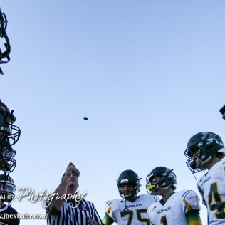 The Head Referee tosses the coin prior to the start of the game. The Pratt Greenbacks win 31 to 16 over the Larned Indians at Earl Roberts Field in Larned, Kansas on September 2, 2016. (Photo: Joey Bahr, www.joeybahr.com)