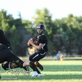 Larned Indian Carson Smith (#5) looks for an open receiver. The Pratt Greenbacks win 31 to 16 over the Larned Indians at Earl Roberts Field in Larned, Kansas on September 2, 2016. (Photo: Joey Bahr, www.joeybahr.com)