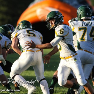 Pratt Greenback Landen Studer (#6) hands the ball off to Travis Theis (#5). The Pratt Greenbacks win 31 to 16 over the Larned Indians at Earl Roberts Field in Larned, Kansas on September 2, 2016. (Photo: Joey Bahr, www.joeybahr.com)
