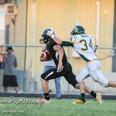 Pratt Greenback Logan Baird (#34) closes in on Larned Indian Kolby Keith (#4). The Pratt Greenbacks win 31 to 16 over the Larned Indians at Earl Roberts Field in Larned, Kansas on September 2, 2016. (Photo: Joey Bahr, www.joeybahr.com)