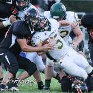 Pratt Greenback Travis Theis (#5) grimaces as he is tackled. The Pratt Greenbacks win 31 to 16 over the Larned Indians at Earl Roberts Field in Larned, Kansas on September 2, 2016. (Photo: Joey Bahr, www.joeybahr.com)