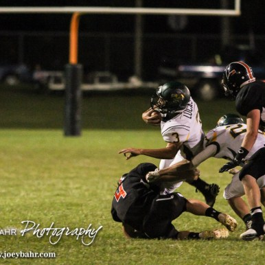 Pratt Greenback Nick Lucas (#3) runs around the tackle of Larned Indian Kolby Keith (#4). The Pratt Greenbacks win 31 to 16 over the Larned Indians at Earl Roberts Field in Larned, Kansas on September 2, 2016. (Photo: Joey Bahr, www.joeybahr.com)
