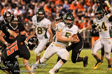 Pratt Greenback Travis Theis (#5) cuts away from the tackle of Larned Indian Dalton Bright (#15) The Pratt Greenbacks win 31 to 16 over the Larned Indians at Earl Roberts Field in Larned, Kansas on September 2, 2016. (Photo: Joey Bahr, www.joeybahr.com)