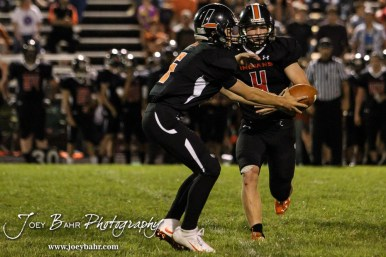 Larned Indian Carson Smith (#5) hands the ball off to Kolby Keith (#4). The Pratt Greenbacks win 31 to 16 over the Larned Indians at Earl Roberts Field in Larned, Kansas on September 2, 2016. (Photo: Joey Bahr, www.joeybahr.com)