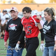 Great Bend Panther Nick Reed (#15) is introduced along with his parents during the Parents Night Ceremony before the game. The Garden City Buffaloes defeated the Great Bend Panthers 21 to 14 in Overtime to win the Western Athletic Conference title at Memorial Stadium in Great Bend, Kansas on October 21, 2016. (Photo: Joey Bahr, www.joeybahr.com)
