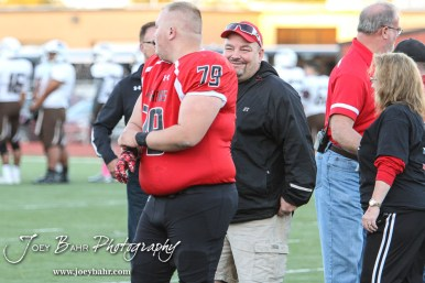 Great Bend Panther Koby Schroeder (#79) is introduced along with his parents during the Parents Night Ceremony before the game. The Garden City Buffaloes defeated the Great Bend Panthers 21 to 14 in Overtime to win the Western Athletic Conference title at Memorial Stadium in Great Bend, Kansas on October 21, 2016. (Photo: Joey Bahr, www.joeybahr.com)