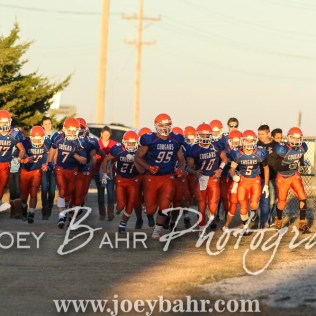Otis-Bison Cougar Bryce Maneth (#95) leads his teammates towards the field. The Otis-Bison Cougars defeated the Greeley County Jackrabbits 62 to 6 at Cougar Field in Otis, Kansas on October 7, 2016. (Photo: Joey Bahr, www.joeybahr.com)