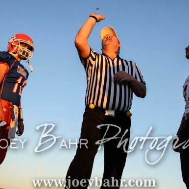 Team captains watch the coin toss. The Otis-Bison Cougars defeated the Greeley County Jackrabbits 62 to 6 at Cougar Field in Otis, Kansas on October 7, 2016. (Photo: Joey Bahr, www.joeybahr.com)