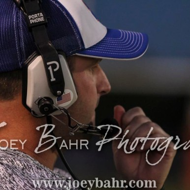 Otis-Bison Cougar Head Coach Travis Starr watches a play develop. The Otis-Bison Cougars defeated the Greeley County Jackrabbits 62 to 6 at Cougar Field in Otis, Kansas on October 7, 2016. (Photo: Joey Bahr, www.joeybahr.com)