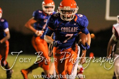 Otis-Bison Cougar Blake Bahr (#7) dashes down the field. The Otis-Bison Cougars defeated the Greeley County Jackrabbits 62 to 6 at Cougar Field in Otis, Kansas on October 7, 2016. (Photo: Joey Bahr, www.joeybahr.com)