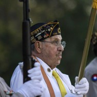 A VFW Member holds the American Flag during the National Anthem. The Hoisington Cardinals defeated the Ellsworth Bearcats 39 to 20 at Shanelac Field in Ellsworth, Kansas on October 14, 2016. (Photo: Joey Bahr, www.joeybahr.com)