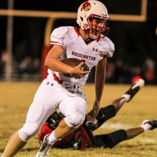 Hoisington Cardinal Tyler Specht (#1) rushes with the ball. The Hoisington Cardinals defeated the Ellsworth Bearcats 39 to 20 at Shanelac Field in Ellsworth, Kansas on October 14, 2016. (Photo: Joey Bahr, www.joeybahr.com)