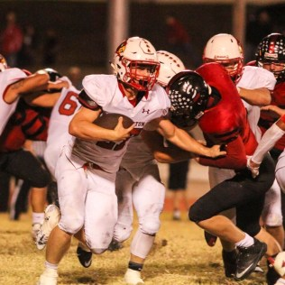 Hoisington Cardinal Hunter Hanzlick (#27) looks for a hole to run through. The Hoisington Cardinals defeated the Ellsworth Bearcats 39 to 20 at Shanelac Field in Ellsworth, Kansas on October 14, 2016. (Photo: Joey Bahr, www.joeybahr.com)