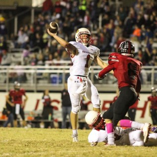 Hoisington Cardinal Tyler Specht (#1) throws a pass as Ellsworth Bearcat Colton Hower (#8) pressures him. The Hoisington Cardinals defeated the Ellsworth Bearcats 39 to 20 at Shanelac Field in Ellsworth, Kansas on October 14, 2016. (Photo: Joey Bahr, www.joeybahr.com)