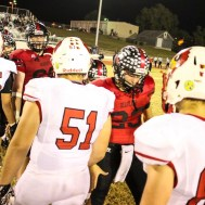 Members of the Ellsworth Bearcats and Hoisington Cardinals shake hands following the game. The Hoisington Cardinals defeated the Ellsworth Bearcats 39 to 20 at Shanelac Field in Ellsworth, Kansas on October 14, 2016. (Photo: Joey Bahr, www.joeybahr.com)