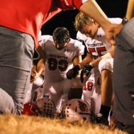 The Hoisington Cardinals kneel in prayer following the game. The Hoisington Cardinals defeated the Ellsworth Bearcats 39 to 20 at Shanelac Field in Ellsworth, Kansas on October 14, 2016. (Photo: Joey Bahr, www.joeybahr.com)