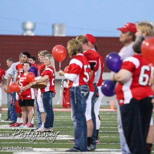 Seniors and their Parents stand on the field for recognition prior to the game. The Hoisington Cardinals defeated the Lyons Lions to win the KSHSAA Class 3A District 15 Championship at Elton Brown Field in Hoisington, Kansas on October 27, 2016. (Photo: Joey Bahr, www.joeybahr.com)