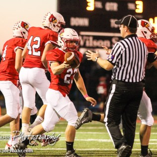 Hoisington Cardinal Sean Urban (#23) hands the ball to a referee after recovering it on the opening kickoff. The Hoisington Cardinals defeated the Lyons Lions to win the KSHSAA Class 3A District 15 Championship at Elton Brown Field in Hoisington, Kansas on October 27, 2016. (Photo: Joey Bahr, www.joeybahr.com)