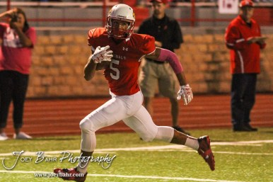 Hoisington Cardinal Cameron Davis (#5) dashes down the field towards the end zone. The Hoisington Cardinals defeated the Lyons Lions to win the KSHSAA Class 3A District 15 Championship at Elton Brown Field in Hoisington, Kansas on October 27, 2016. (Photo: Joey Bahr, www.joeybahr.com)