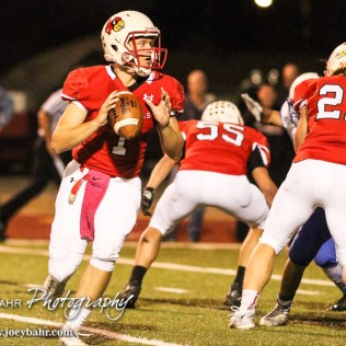 Hoisington Cardinal Tyler Specht (#1) rolls out looking for a receiver to throws a pass to. The Hoisington Cardinals defeated the Lyons Lions to win the KSHSAA Class 3A District 15 Championship at Elton Brown Field in Hoisington, Kansas on October 27, 2016. (Photo: Joey Bahr, www.joeybahr.com)