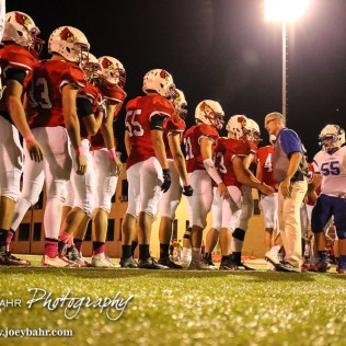 Lyons Lion Head Coach James Johnston shakes the hands of Hoisington Cardinal players after the game. The Hoisington Cardinals defeated the Lyons Lions to win the KSHSAA Class 3A District 15 Championship at Elton Brown Field in Hoisington, Kansas on October 27, 2016. (Photo: Joey Bahr, www.joeybahr.com)