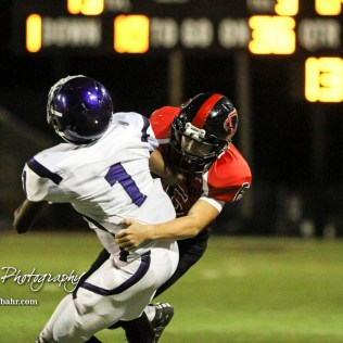 Great Bend Panther Max Jerke (#6) tackles Topeka West Charger Brian Wright (#1). The Great Bend Panthers defeated the Topeka West Chargers 70 to 31 in a KSHSAA Class 5A First Round matchup. at Memorial Stadium in Great Bend, Kansas on October 28, 2016. (Photo: Joey Bahr, www.joeybahr.com)