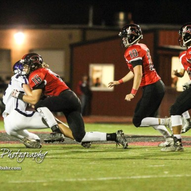 Great Bend Panther Dalton Miller (#16) sacks Topeka West Charger Zach Shima (#10). The Great Bend Panthers defeated the Topeka West Chargers 70 to 31 in a KSHSAA Class 5A First Round matchup. at Memorial Stadium in Great Bend, Kansas on October 28, 2016. (Photo: Joey Bahr, www.joeybahr.com)