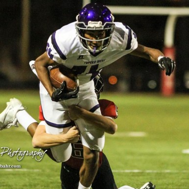 Topeka West Charger Caleb Schmelzle (#14) flies through the air as a Great Bend Panther defender tires to tackle. him. The Great Bend Panthers defeated the Topeka West Chargers 70 to 31 in a KSHSAA Class 5A First Round matchup. at Memorial Stadium in Great Bend, Kansas on October 28, 2016. (Photo: Joey Bahr, www.joeybahr.com)