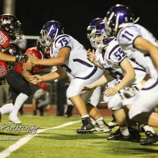 The Topeka West Charger offensive line fire off of the ball. The Great Bend Panthers defeated the Topeka West Chargers 70 to 31 in a KSHSAA Class 5A First Round matchup. at Memorial Stadium in Great Bend, Kansas on October 28, 2016. (Photo: Joey Bahr, www.joeybahr.com)