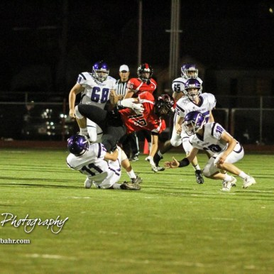 Great Bend Panther Brock Blessing (#18) flies in the air as Topeka West Charger Elliot Mehrens (#11) tackles him. The Great Bend Panthers defeated the Topeka West Chargers 70 to 31 in a KSHSAA Class 5A First Round matchup. at Memorial Stadium in Great Bend, Kansas on October 28, 2016. (Photo: Joey Bahr, www.joeybahr.com)