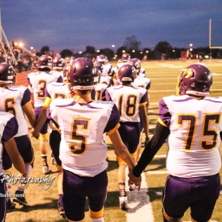 The Lakin Broncs march out onto the field. The Hoisington Cardinals defeated the Lakin Broncs in the KSHSAA Class 3A Bi-District game with a score of 56 to 13 at Elton Brown Field in Hoisington, Kansas on November 1, 2016. (Photo: Joey Bahr, www.joeybahr.com)