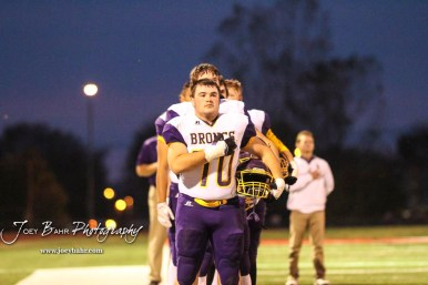 Lakin Bronc Mike Aller (#70) holds his hand over his heart during the playing of the National Anthem. The Hoisington Cardinals defeated the Lakin Broncs in the KSHSAA Class 3A Bi-District game with a score of 56 to 13 at Elton Brown Field in Hoisington, Kansas on November 1, 2016. (Photo: Joey Bahr, www.joeybahr.com)