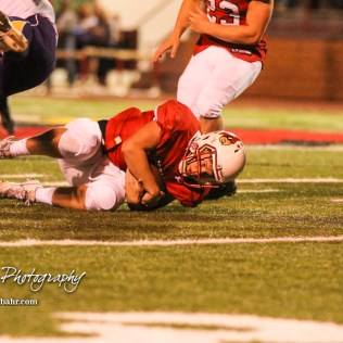 Hoisington Cardinal Tyler Specht (#1) covers up a fumble. The Hoisington Cardinals defeated the Lakin Broncs in the KSHSAA Class 3A Bi-District game with a score of 56 to 13 at Elton Brown Field in Hoisington, Kansas on November 1, 2016. (Photo: Joey Bahr, www.joeybahr.com)