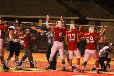 Hoisington Cardinal Cameron Davis (#5) celebrates a touchdown as a referee waves it off. The Hoisington Cardinals defeated the Lakin Broncs in the KSHSAA Class 3A Bi-District game with a score of 56 to 13 at Elton Brown Field in Hoisington, Kansas on November 1, 2016. (Photo: Joey Bahr, www.joeybahr.com)