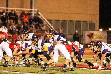 Lakin Bronc Hunter Kirby (#5) calls out the cadence. The Hoisington Cardinals defeated the Lakin Broncs in the KSHSAA Class 3A Bi-District game with a score of 56 to 13 at Elton Brown Field in Hoisington, Kansas on November 1, 2016. (Photo: Joey Bahr, www.joeybahr.com)