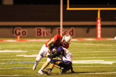 Lakin Bronc Coy Adams (#4) takes the brunt of Hoisington Cardinal Hunter Hanzlick (#27) lowering his shoulders into him. The Hoisington Cardinals defeated the Lakin Broncs in the KSHSAA Class 3A Bi-District game with a score of 56 to 13 at Elton Brown Field in Hoisington, Kansas on November 1, 2016. (Photo: Joey Bahr, www.joeybahr.com)