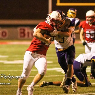 Lakin Bronc Jeff Gilleland (#3) tries to hold onto Hoisington Cardinal Hunter Hanzlick (#27). The Hoisington Cardinals defeated the Lakin Broncs in the KSHSAA Class 3A Bi-District game with a score of 56 to 13 at Elton Brown Field in Hoisington, Kansas on November 1, 2016. (Photo: Joey Bahr, www.joeybahr.com)
