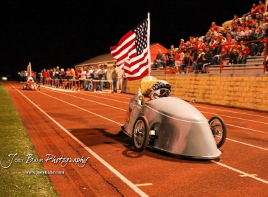 An electric car built by Hoisington High School students drives to celebrate a touchdown being scored. The Hoisington Cardinals defeated the Lakin Broncs in the KSHSAA Class 3A Bi-District game with a score of 56 to 13 at Elton Brown Field in Hoisington, Kansas on November 1, 2016. (Photo: Joey Bahr, www.joeybahr.com)