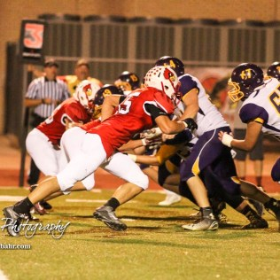 Hoisington Cardinal Grant Dolechek (#55) takes off towards the Lakin Bronc back field. The Hoisington Cardinals defeated the Lakin Broncs in the KSHSAA Class 3A Bi-District game with a score of 56 to 13 at Elton Brown Field in Hoisington, Kansas on November 1, 2016. (Photo: Joey Bahr, www.joeybahr.com)