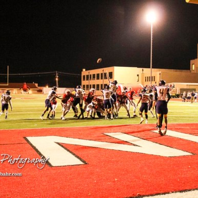 A Point After Touchdown attempt sails over the heads of the players. The Hoisington Cardinals defeated the Lakin Broncs in the KSHSAA Class 3A Bi-District game with a score of 56 to 13 at Elton Brown Field in Hoisington, Kansas on November 1, 2016. (Photo: Joey Bahr, www.joeybahr.com)