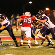 Hoisington Cardinal Justin Bradley (#69) shoots up a gap in the Lakin Bronc Offensive Line. The Hoisington Cardinals defeated the Lakin Broncs in the KSHSAA Class 3A Bi-District game with a score of 56 to 13 at Elton Brown Field in Hoisington, Kansas on November 1, 2016. (Photo: Joey Bahr, www.joeybahr.com)